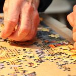 hands doing personalised jigsaw puzzle